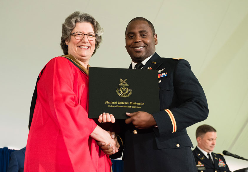 Chancellor Janice Hamby (ADM, USN, Ret.), with graduating CIC student.