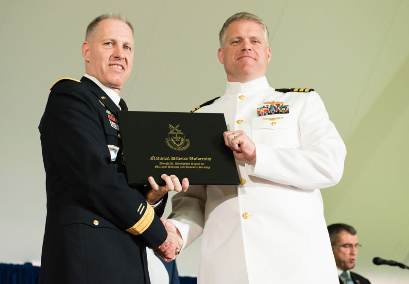 Eisenhower School Commandant, Brigadier General Paul H. Fredenburgh III, USA, with graduating Eisenhower student.