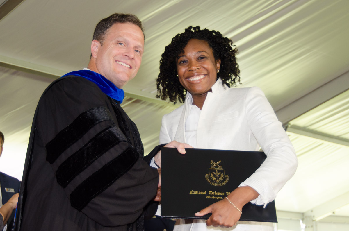 Michael S. Bell, Ph.D. (Colonel, USA, Ret.), Chancellor, CISA, with graduating CISA student.