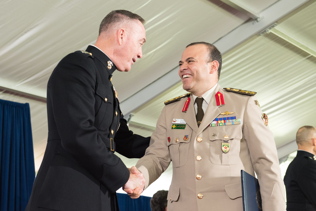 Chairman of the Joint Chiefs of Staff Gen Joseph Dunford Jr., USMC, with graduating Eisenhower student.