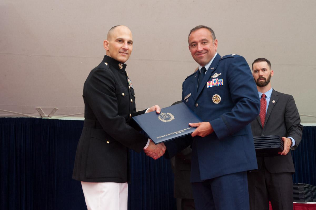 Brigadier General Thomas A. Gorry, USMC, Commandant, Eisenhower School, with graduating Eisenhower student.