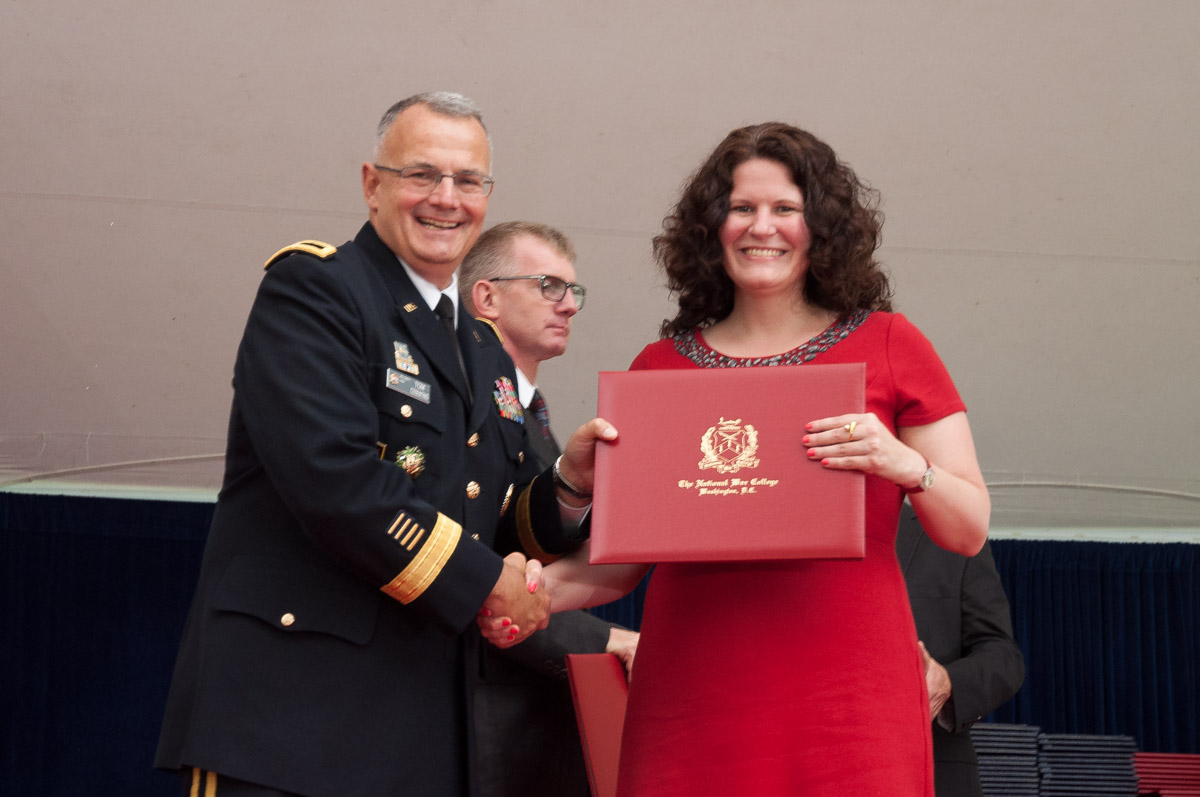 Brigadier General Guy T. Cosentino, USA, Commandant, NWC, with graduating NWC student.
