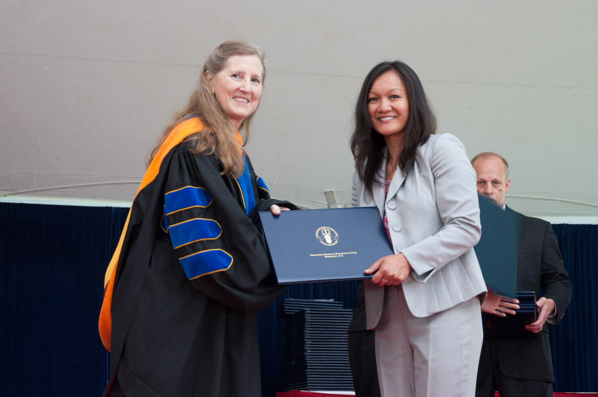 Mary S. McCully, Ph.D. (Colonel, USAF, Ret.), Acting Chancellor, iCollege with graduating iCollege student.